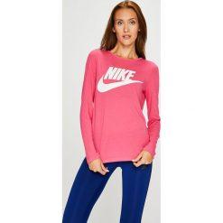 Nike Sportswear - Bluzka. Różowe bluzki asymetryczne Nike Sportswear, s, z nadrukiem, z dzianiny, z okrągłym kołnierzem. W wyprzedaży za 139,90 zł.