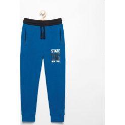 Spodnie dresowe - Niebieski. Niebieskie chinosy chłopięce Reserved, z dresówki. Za 49,99 zł.