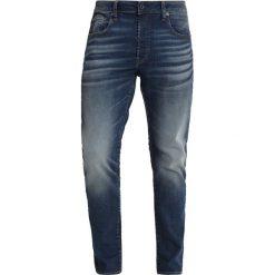 GStar 3301 SLIM Jeansy Slim Fit dark aged. Niebieskie jeansy męskie relaxed fit G-Star. Za 609,00 zł.