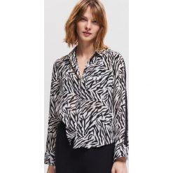Koszula ze zwierzęcym motywem - Biały. Białe koszule damskie marki Reserved, z motywem zwierzęcym. Za 79,99 zł.
