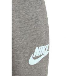 Chinosy chłopięce: Nike Performance MODERN  Spodnie treningowe carbon heather/cool grey/cool grey/glacier blue