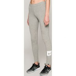 Nike Sportswear - Legginsy. Różowe legginsy marki Nike Sportswear, l, z nylonu, z okrągłym kołnierzem. Za 99,90 zł.