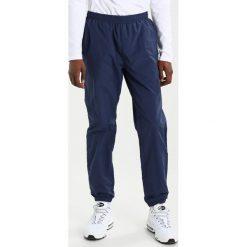 Spodnie męskie: Ellesse BOLZANO Spodnie treningowe dress blues