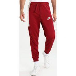 Spodnie męskie: Nike Sportswear Dres team red/light bone