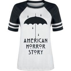 American Horror Story Umbrella Koszulka damska biały/czarny. Białe bluzki z odkrytymi ramionami American Horror Story, l, z nadrukiem, z okrągłym kołnierzem. Za 99,90 zł.