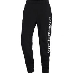 Calvin Klein Jeans INSTITUTIONAL SIDE PANTS Spodnie treningowe black. Czarne spodnie dresowe męskie Calvin Klein Jeans, z bawełny. Za 419,00 zł.