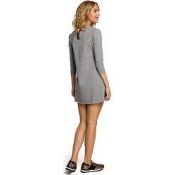 LENA Mini sukienka – tunika z kieszenią w kształcie serca - szara. Niebieskie sukienki mini marki numoco, na imprezę, s, w kwiaty, z jeansu, sportowe, sportowe. Za 99,00 zł.