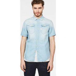 G-Star Raw - Koszula. Szare koszule męskie jeansowe G-Star RAW, l, z klasycznym kołnierzykiem, z długim rękawem. W wyprzedaży za 359,90 zł.