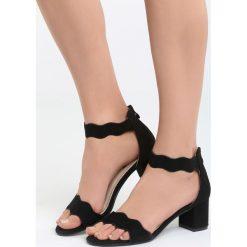 Czarne Sandały End Titles. Czarne sandały damskie na słupku marki Born2be, z materiału, na wysokim obcasie. Za 59,99 zł.