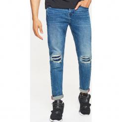 Jeansy COMFORT - Granatowy. Niebieskie jeansy męskie regular Cropp. Za 129,99 zł.