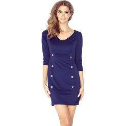 Crystal Sukienka z dekoltem 8 GUZIKÓW - GRANATOWA. Niebieskie sukienki hiszpanki morimia, s, z materiału, z dekoltem w serek. Za 139,99 zł.