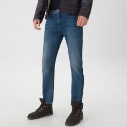 Jeansy typu slim - Granatowy. Czarne jeansy męskie slim marki KIPSTA, z poliesteru, do piłki nożnej. Za 139,99 zł.