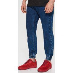 Jeansy JOGGER - Granatowy. Niebieskie jeansy męskie marki QUECHUA, m, z elastanu. Za 99,99 zł.