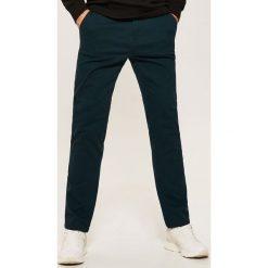 Chinosy męskie: Spodnie CHINO - Granatowy