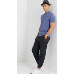 Hackett London Koszulka polo blue. Niebieskie koszulki polo Hackett London, m, z bawełny. Za 419,00 zł.