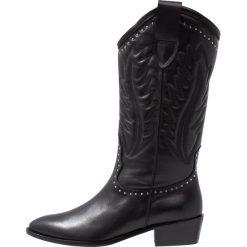 Toral Kowbojki i obuwie motocyklowe black. Czarne buty zimowe damskie marki Toral, z materiału. Za 969,00 zł.