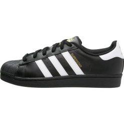 Adidas Originals SUPERSTAR FOUNDATION Tenisówki i Trampki noir / blanc. Czarne tenisówki damskie marki adidas Originals, z materiału. W wyprzedaży za 359,10 zł.