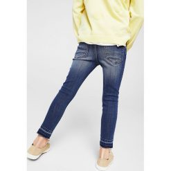 Mango Kids - Jeansy dziecięce Allegra 104-164 cm. Niebieskie jeansy dziewczęce Mango Kids, z aplikacjami, z bawełny. W wyprzedaży za 49,90 zł.