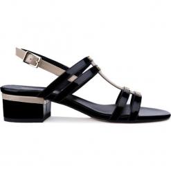 Sandały. Czarne sandały damskie Gino Rossi, z lakierowanej skóry, na obcasie. Za 99,90 zł.