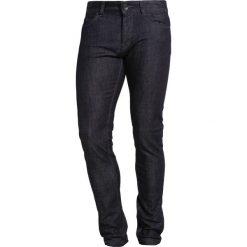 Benetton Jeans Skinny Fit raw. Czarne jeansy męskie marki Benetton. W wyprzedaży za 127,20 zł.