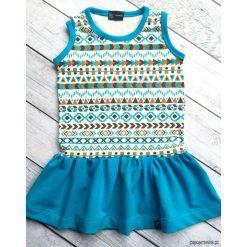 Letnia sukienka w azteckie wzory. Czerwone sukienki dziewczęce marki Pakamera, z dzianiny. Za 99,00 zł.