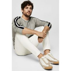 Mango Man - Jeansy Jan2. Białe jeansy męskie slim marki Mango Man. W wyprzedaży za 99,90 zł.
