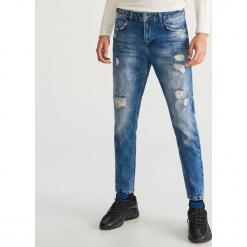 Przecierane jeansy - Niebieski. Niebieskie jeansy męskie marki QUECHUA, m, z elastanu. Za 129,99 zł.