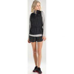 Puma EXPLOSIVE RUN VEST  Koszulka sportowa black. Czarne topy sportowe damskie marki Puma, s, z materiału. W wyprzedaży za 209,30 zł.