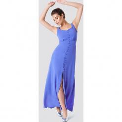 Trendyol Sukienka z guziki z rozcięciem - Blue. Szare sukienki z falbanami marki Trendyol, na co dzień, z elastanu, casualowe, midi, dopasowane. W wyprzedaży za 101,48 zł.