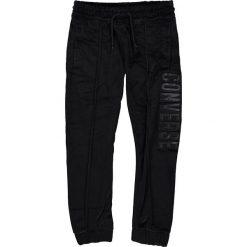 Spodnie dresowe w kolorze czarnym. Brązowe dresy chłopięce marki bonprix, melanż, z dresówki. W wyprzedaży za 82,95 zł.