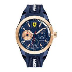 """Zegarek """"0830379-RED-REV-T"""" w kolorze granatowo-złotym. Niebieskie, analogowe zegarki męskie Lacoste, sztuczne. W wyprzedaży za 687,95 zł."""