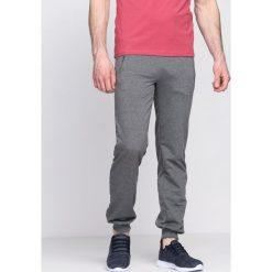 Ciemnoszare Spodnie Dresowe It's On. Czarne spodnie dresowe męskie marki Born2be, l, z aplikacjami, z dresówki. Za 29,99 zł.