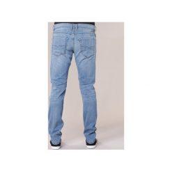 Jeansy slim fit Diesel  TEPPHAR. Niebieskie jeansy męskie relaxed fit Diesel. Za 527,20 zł.