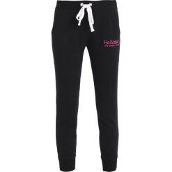 Spodnie dresowe damskie: Hollister Co. LOGO JOGGER  Spodnie treningowe black