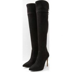 MICHAEL Michael Kors JAMIE Kozaki na obcasie black. Czarne buty zimowe damskie marki MICHAEL Michael Kors, z gumy, przed kolano, na wysokim obcasie. W wyprzedaży za 869,25 zł.