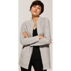 Długa bluza - Jasny szar. Czarne długie bluzy damskie marki KIPSTA, z poliesteru, do piłki nożnej. Za 139,99 zł.