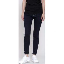Granatowe Jeansy Maybellene. Niebieskie jeansy damskie other. Za 49,99 zł.