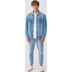 Jeansy relaxed fit. Niebieskie jeansy męskie regular Pull&Bear. Za 139,00 zł.