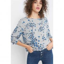 Bluzka w kwiaty. Niebieskie bluzki asymetryczne Orsay, w kwiaty, z materiału. Za 89,99 zł.