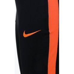Nike Performance DRY PANT Spodnie treningowe black/black/cone/cone. Czarne spodnie chłopięce Nike Performance, z materiału. Za 139,00 zł.