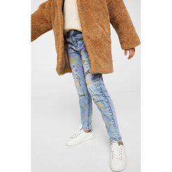 Mango Kids - Jeansy dziecięce print 116-164 cm. Niebieskie jeansy dziewczęce Mango Kids, z bawełny. W wyprzedaży za 69,90 zł.