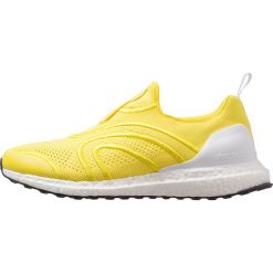 Adidas by Stella McCartney ULTRA BOOST UNCAGED Obuwie do biegania treningowe vivid yellow/footwear white/night steel. Żółte buty do biegania damskie adidas by Stella McCartney, z materiału. W wyprzedaży za 678,30 zł.