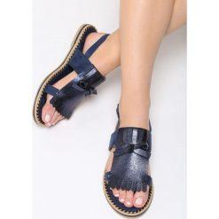 Niebieskie Sandały Cosmic Splash. Niebieskie sandały damskie marki Born2be, z materiału, na obcasie. Za 69,99 zł.