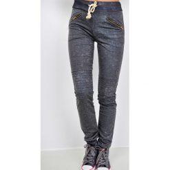 Spodnie sportowe damskie: Spodnie dresowe melanżowe