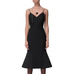 Sukienka w kolorze czarnym. Czarne sukienki na komunię marki BOHOBOCO, z dekoltem na plecach, midi. W wyprzedaży za 1389,95 zł.