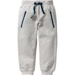 Spodnie dresowe bonprix kremowy melanż. Czarne spodnie chłopięce marki bonprix, w paski, z dresówki. Za 24,99 zł.
