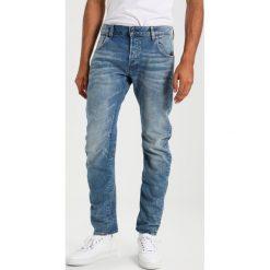 GStar ARC 3D SLIM Jeansy Slim Fit lyse stretch denim. Szare rurki męskie marki G-Star. W wyprzedaży za 391,30 zł.
