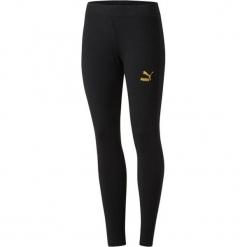 Legginsy w kolorze czarnym. Czarne legginsy we wzory marki Puma, xs. W wyprzedaży za 90,95 zł.