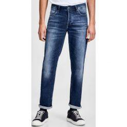 Dżinsy slim. Niebieskie jeansy męskie slim marki Jack & Jones. Za 249,86 zł.