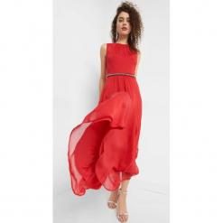 Sukienka maxi z brylancikami. Czarne długie sukienki marki Orsay, xs, z bawełny, z dekoltem na plecach. Za 199,99 zł.